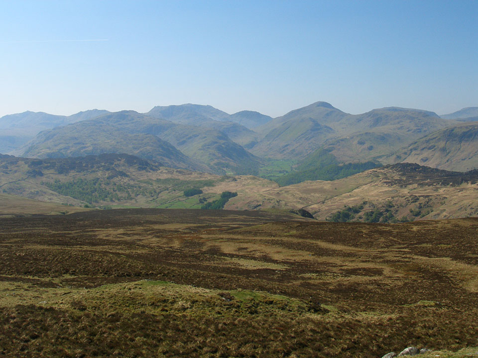 he view to the south from High Seat, looking towards Bow Fell, Esk Pike, the Scafells, Lingmell, Great Gable and Kirk Fell