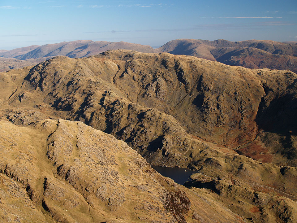 Looking over Levers Water to Black Sails and Wetherlam to Helvellyn and Fairfield from the summit of Coniston Old Man