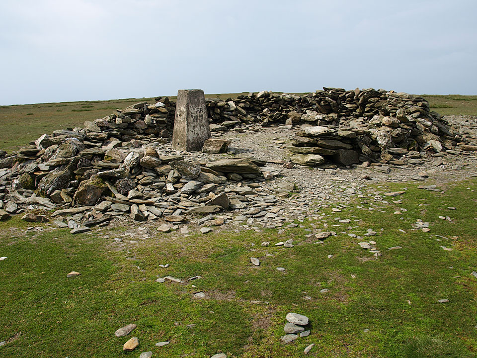 The shelter and trig column at the summit