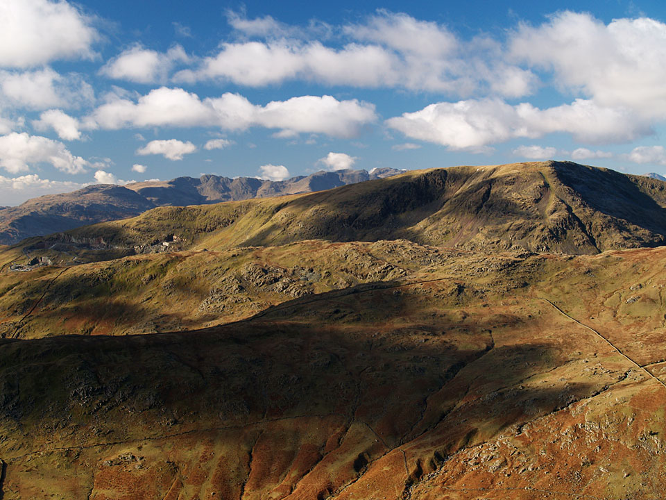 Red Screes over Caudale Moor with Lingmoor Fell, Crinkle Crags and Bow Fell beyond, from Froswick