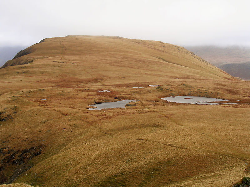 Illgill Head in mist over the tarns from Whin Rigg