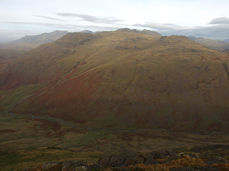 A glimpse of the Scafells beyond Wrynose Fell from Hell Gill Pike.