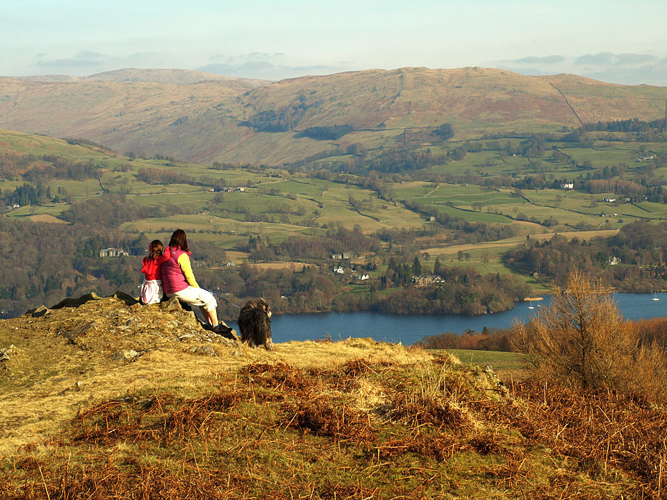 Connie, Louise and Angus take in the spectacular view over Windermere on the north-eastern side of Latterbarrow - Sour Howes is the fell opposite