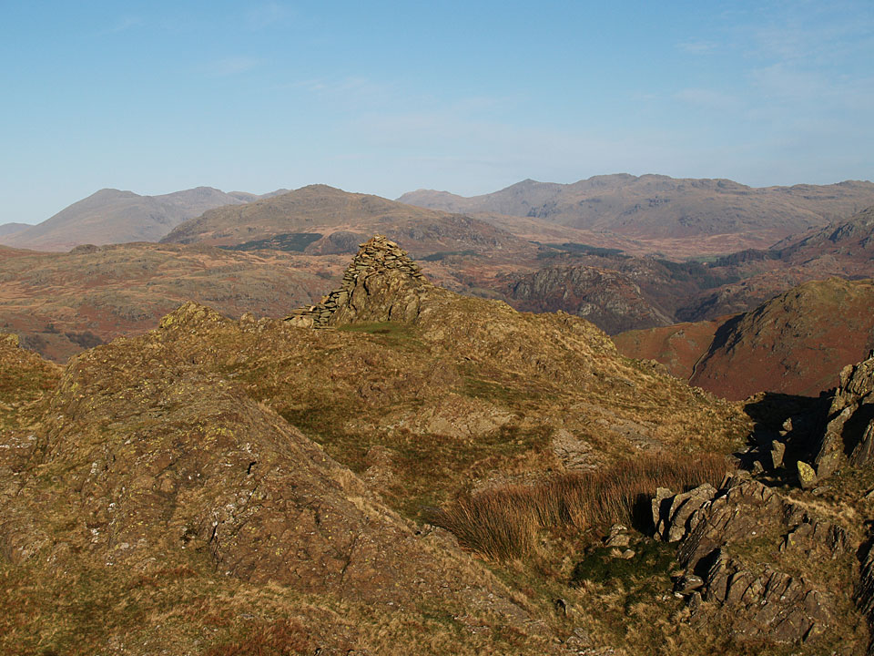 A clear view to Harter Fell with the Scafell range, Esk Pike and Bow Fell beyond from the summit