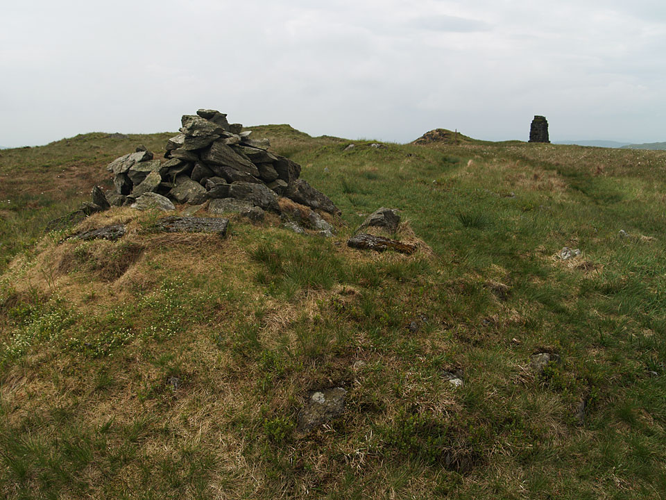 The summit of Tarn Crag with a survey column, a remnant from construction of the Haweswater aqueduct, beyond