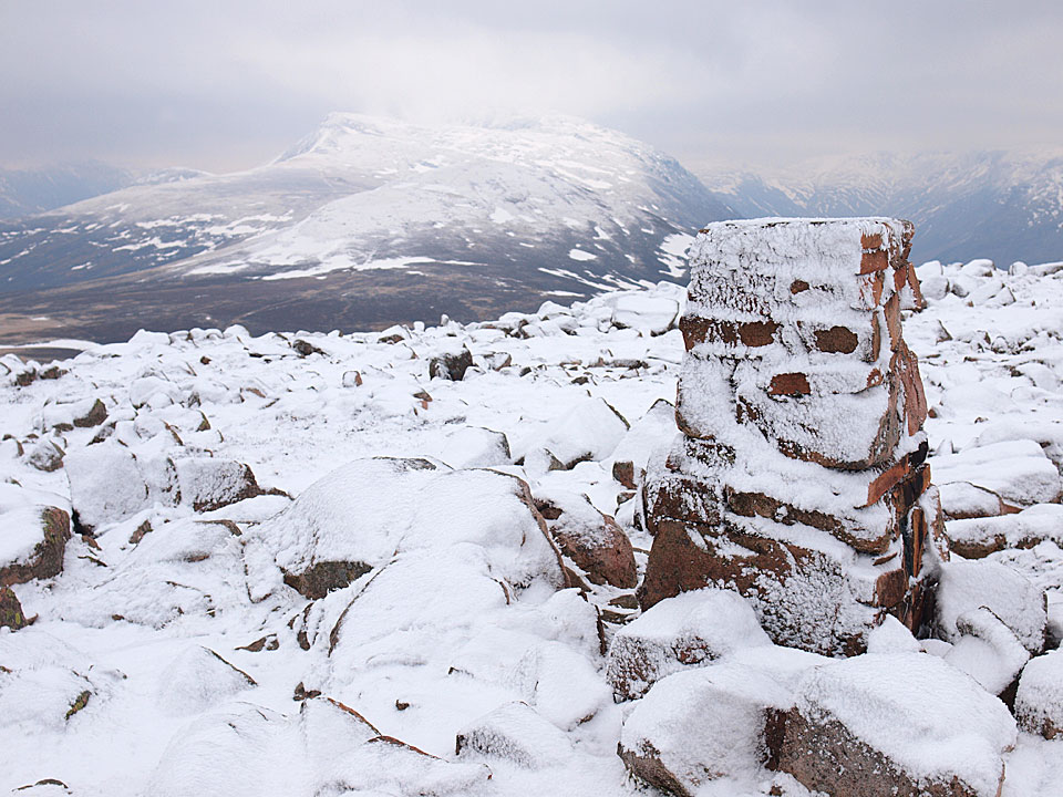 The frozen summit of Great Borne with the pointed Red Pike in view