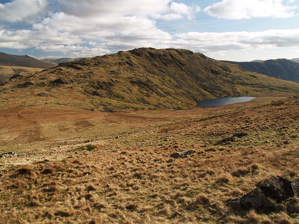 Middle Fell and Greendale Tarn from the descent of Seatallan