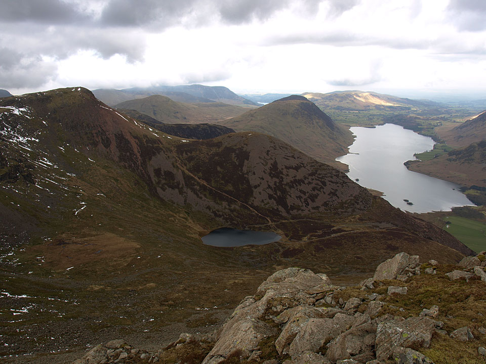 Looking over to Red Pike and Dodd beyond Bleaberry Tarn with Crummock Water and Mellbreak beyond