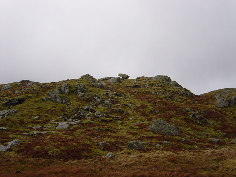 The distinctive balancing stone which marks the summit of Brown Rigg