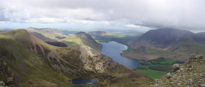 Looking from High Stile across Bleaberry Tarn and Red Pike to Mellbreak and Crummock Water. Loweswater is visible in the distance.