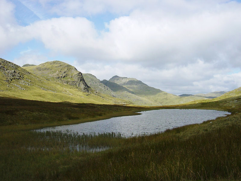 Looking across Red Tarn to Great Knott, the Crinkle Crags and Bow Fell