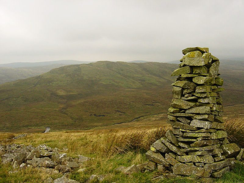 The cairn on Whatshaw Common, with Robin Hood behind