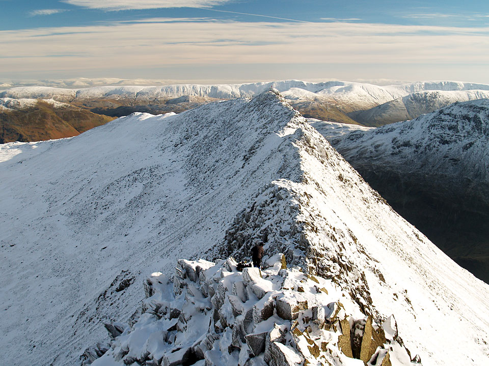 Looking down on Striding Edge from the climb with the High Street range and The Pennines beyond