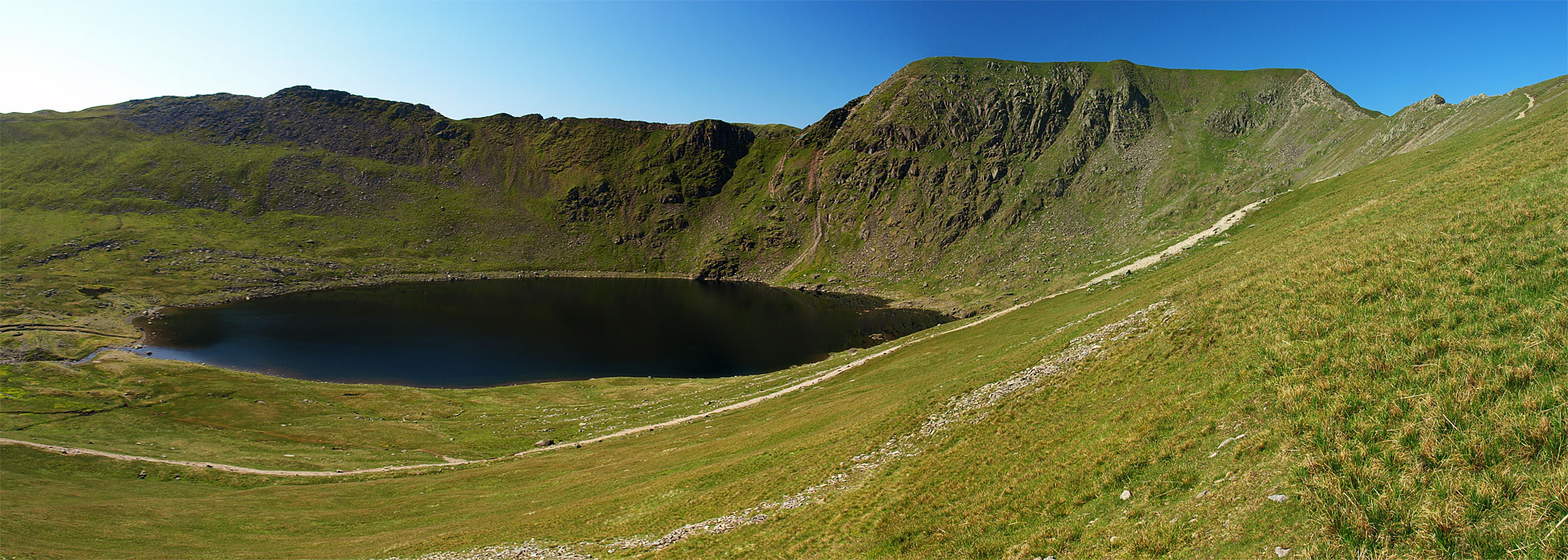 Striding Edge and Helvellyn across Red Tarn from the steep descent from Catstycam