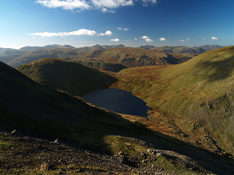Seat Sandal above Grisedale Tarn and the view westwards beyond from Cofa Pike