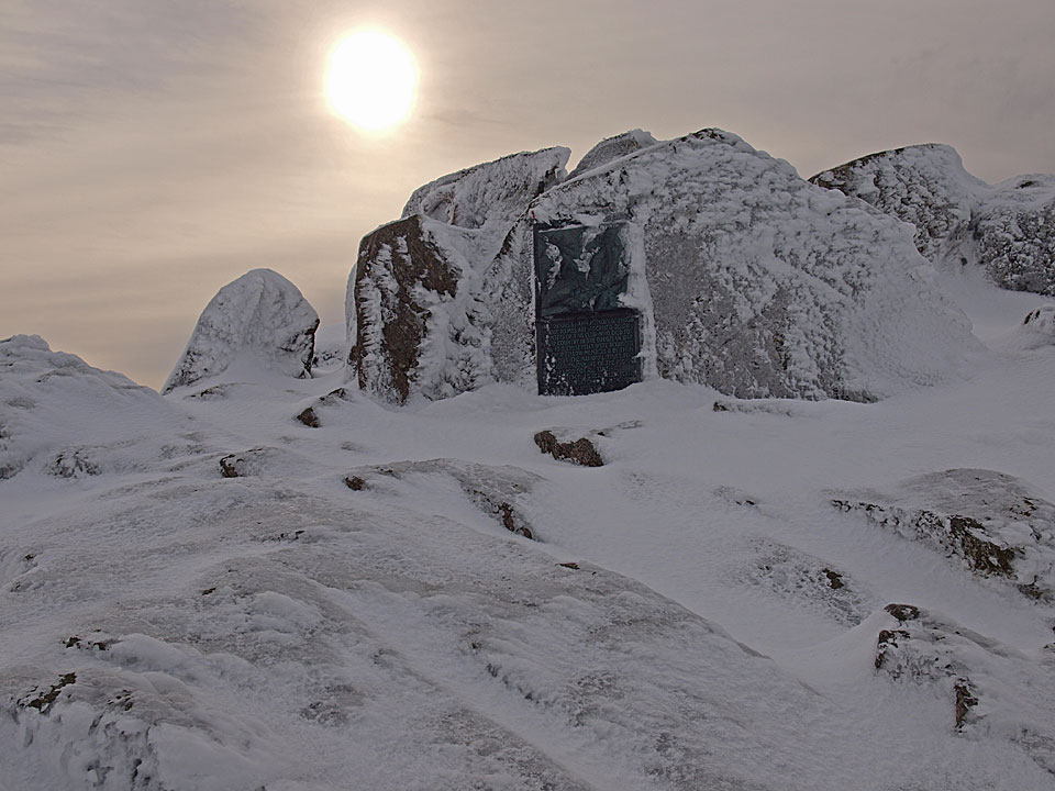 Winter on Great Gable summit with the FRCC memorial plaque in the centre