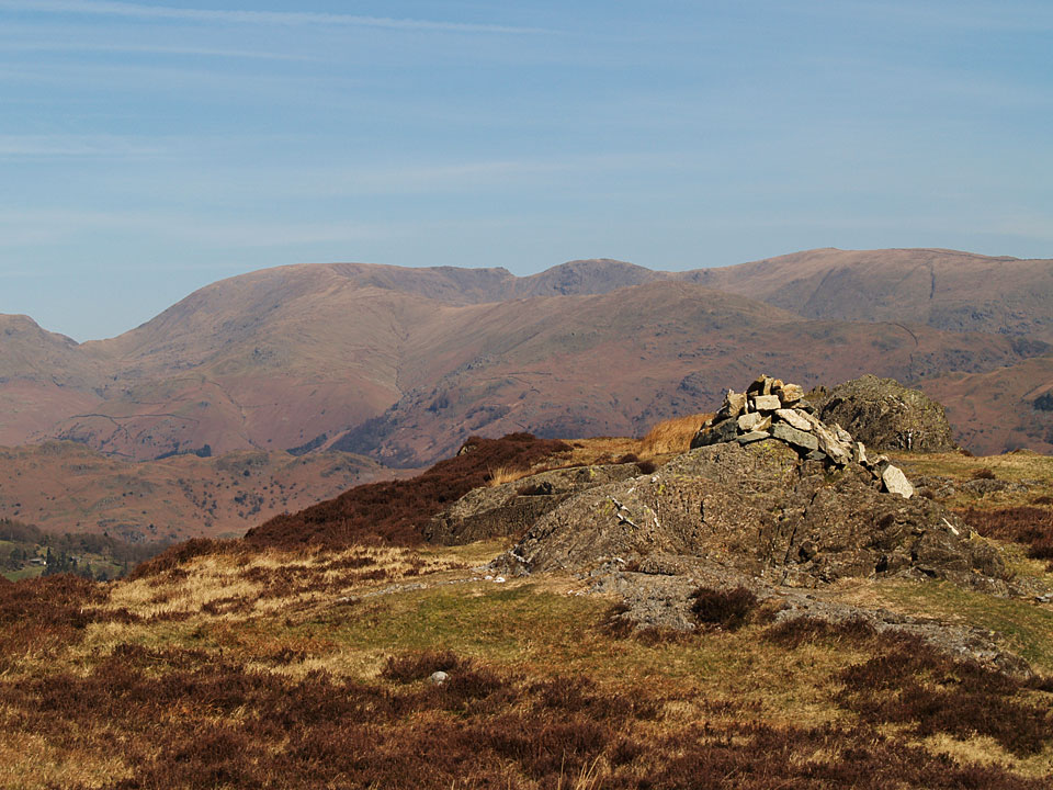 Looking across the summit of Holme Fell to Fairfield, Hart Crag and Dove Crag