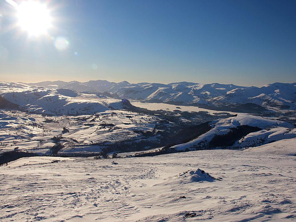 Descending Blease Fell looking across to frozen Derwent Water