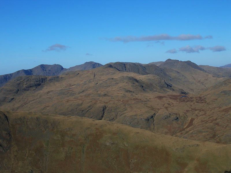 The Scafells, Crinkle Crags and Bow Fell with Cold Pike and Red Tarn in the foreground from Wetherlam.
