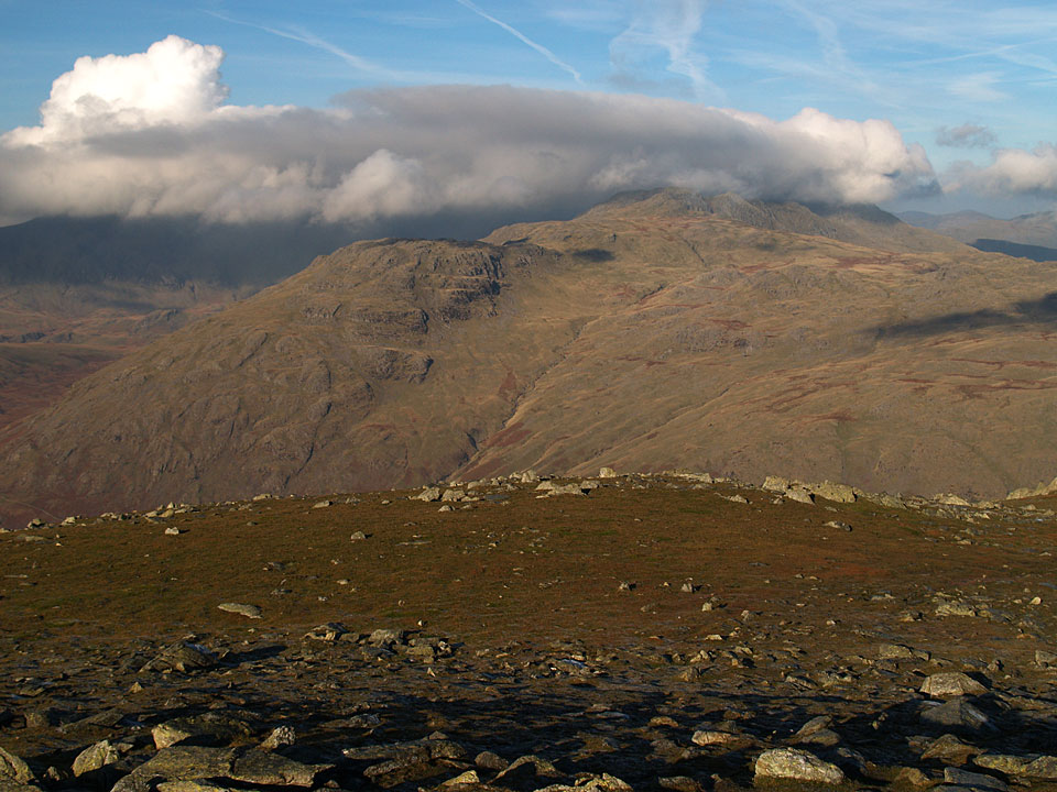 The Scafells, Crinkle Crags and Bowfell are covered by a thick blanket of cloud looking from Great Carrs