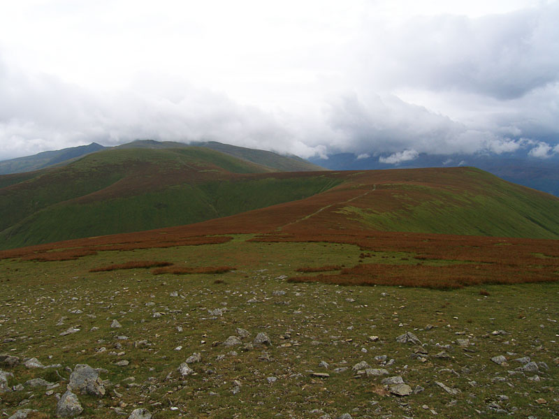 A retrospective view from Great Dodd - in the distance is the pointed Catstycam with Helvellyn in cloud. Centre left is Stybarrow Dodd with Watson's Dodd to the right.