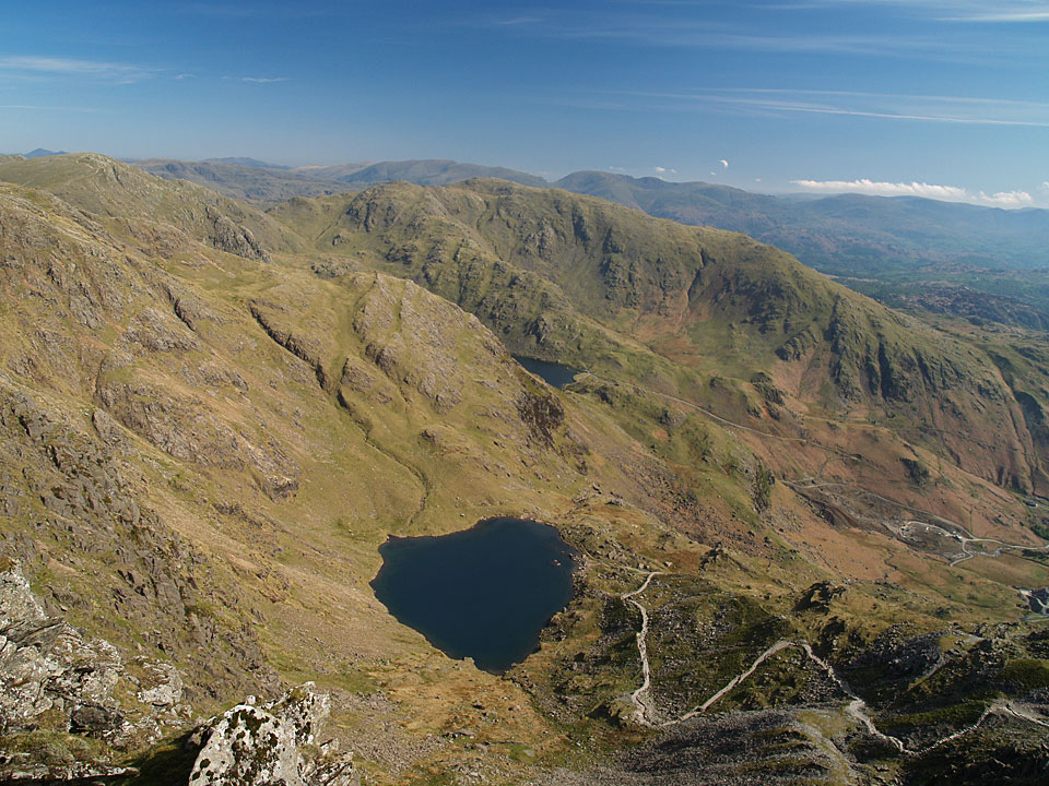 Looking across Low Water, Levers Water and Wetherlam to the eastern fells from the summit of The Old Man