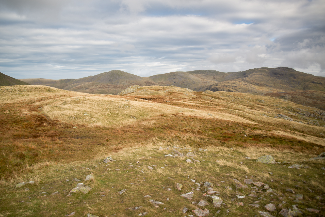 Walking the Middle Fell ridge with Haycock, Scoat Fell and Red Pike in view