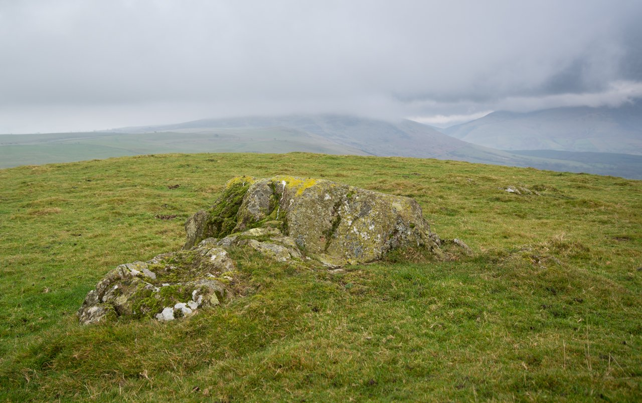 The summit of Caermote Hill, Binsey (under cloud) in the background