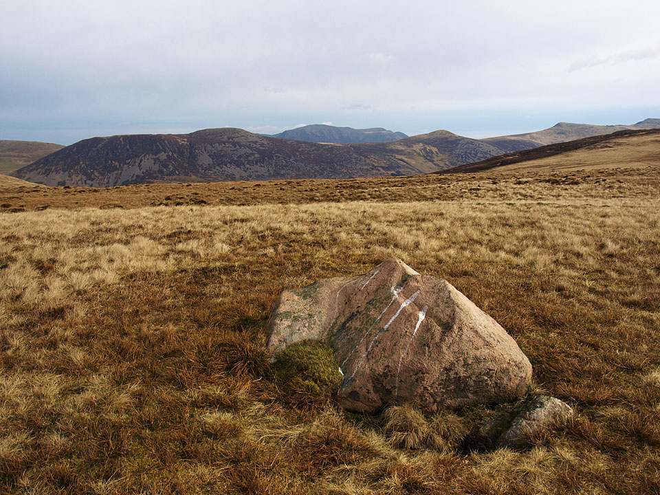 The solitary boulder that marks the top of Whoap, here looking across Great Borne to Grasmoor