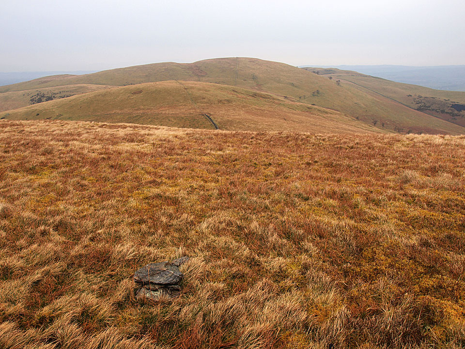 The uninspiring top (and cairn!) on Sourfoot Fell looking to Smithy Fell and Fellbarrow beyond