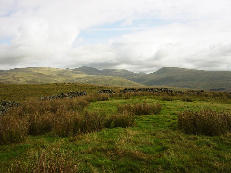 The high fells from the summit of Stone Pike, which is enclosed by a wall
